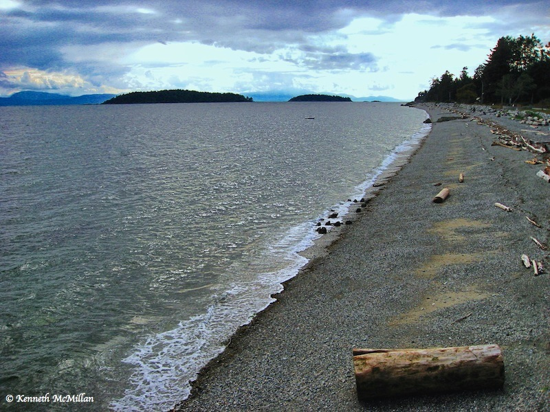 The beach in front of the town of Sechelt, British Columbia, Canada. Looking out onto the Trail Islands, Georgia Straight and Vancouver Island on the horizon.