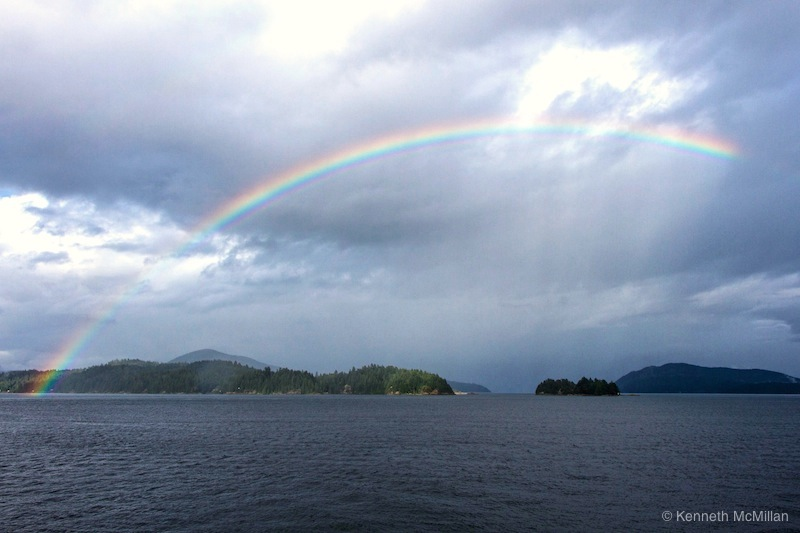 a rainbow over Gambier Island welcomes us home